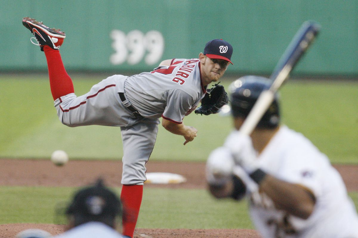 May 10, 2012; Pittsburgh, PA, USA; Washington Nationals starting pitcher Stephen Strasburg (37) pitches against Pittsburgh Pirates third baseman Pedro Alvarez (24) during the second inning at PNC Park. Mandatory Credit: Charles LeClaire-US PRESSWIRE