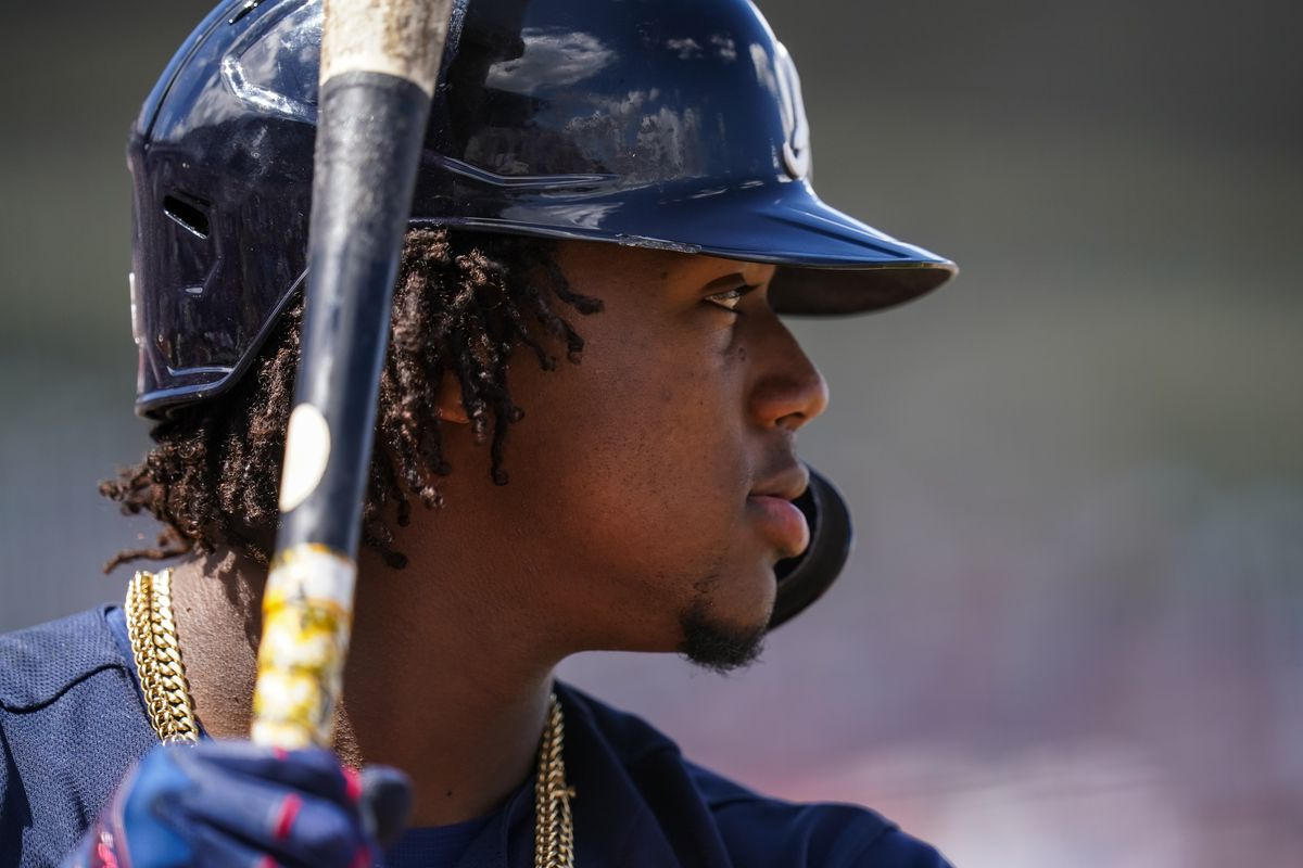 Ronald Acuna Jr. #25 of the Atlanta Braves looks on during a spring training game between the Atlanta Braves and Minnesota Twins on March 11, 2020 at Hammond Stadium in Fort Myers, Florida.