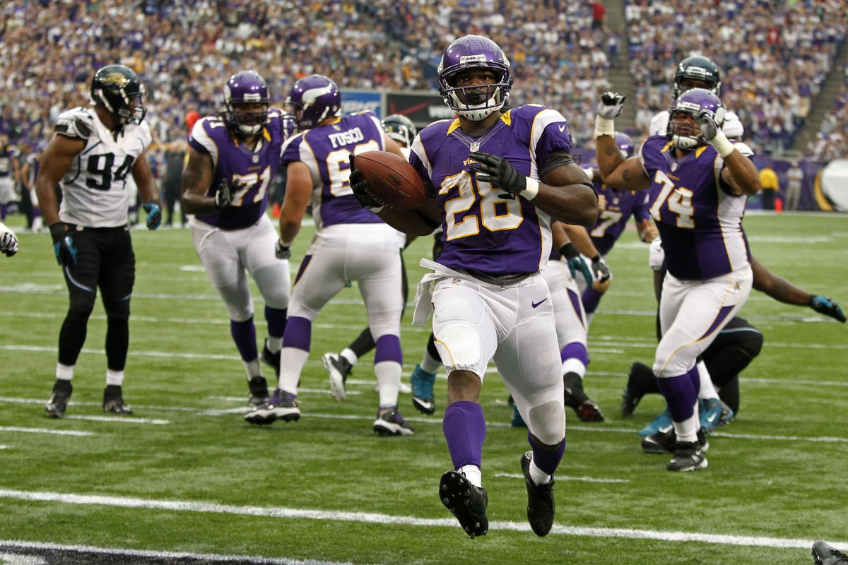 Sep 9, 2012; Minneapolis, MN, USA; Minnesota Vikings running back Adrian Peterson (28) scores a touchdown against the Jacksonville Jaguars in the second quarter at the Metrodome. Mandatory Credit: Bruce Kluckhohn-US PRESSWIRE