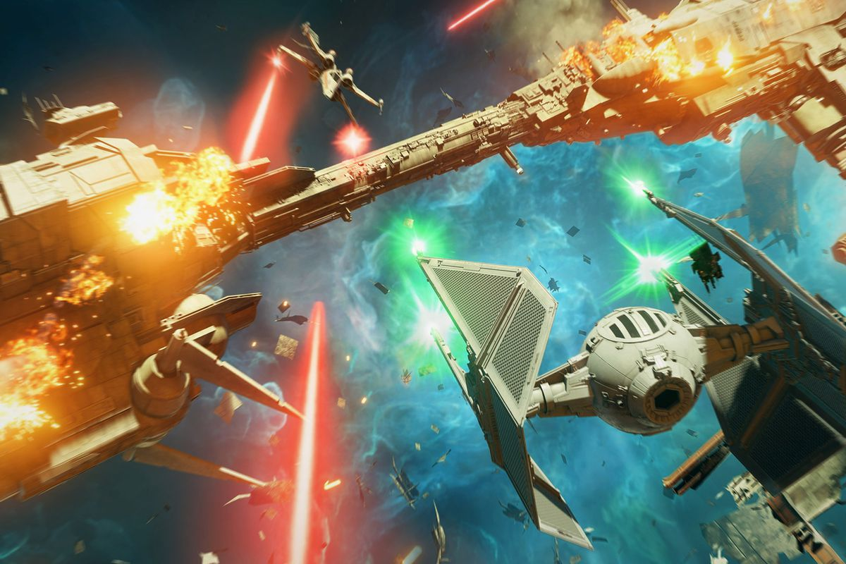 A TIE Interceptor bears down on a New Republic frigate in a blue nebula in Star Wars: Squadrons