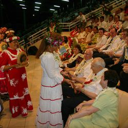 Elder L. Tom Perry of the Quorum of the Twelve receives gifts from Tahitian Latter-day Saints during a cultural event to celebrate rededication of the Papeete Tahiti Temple.