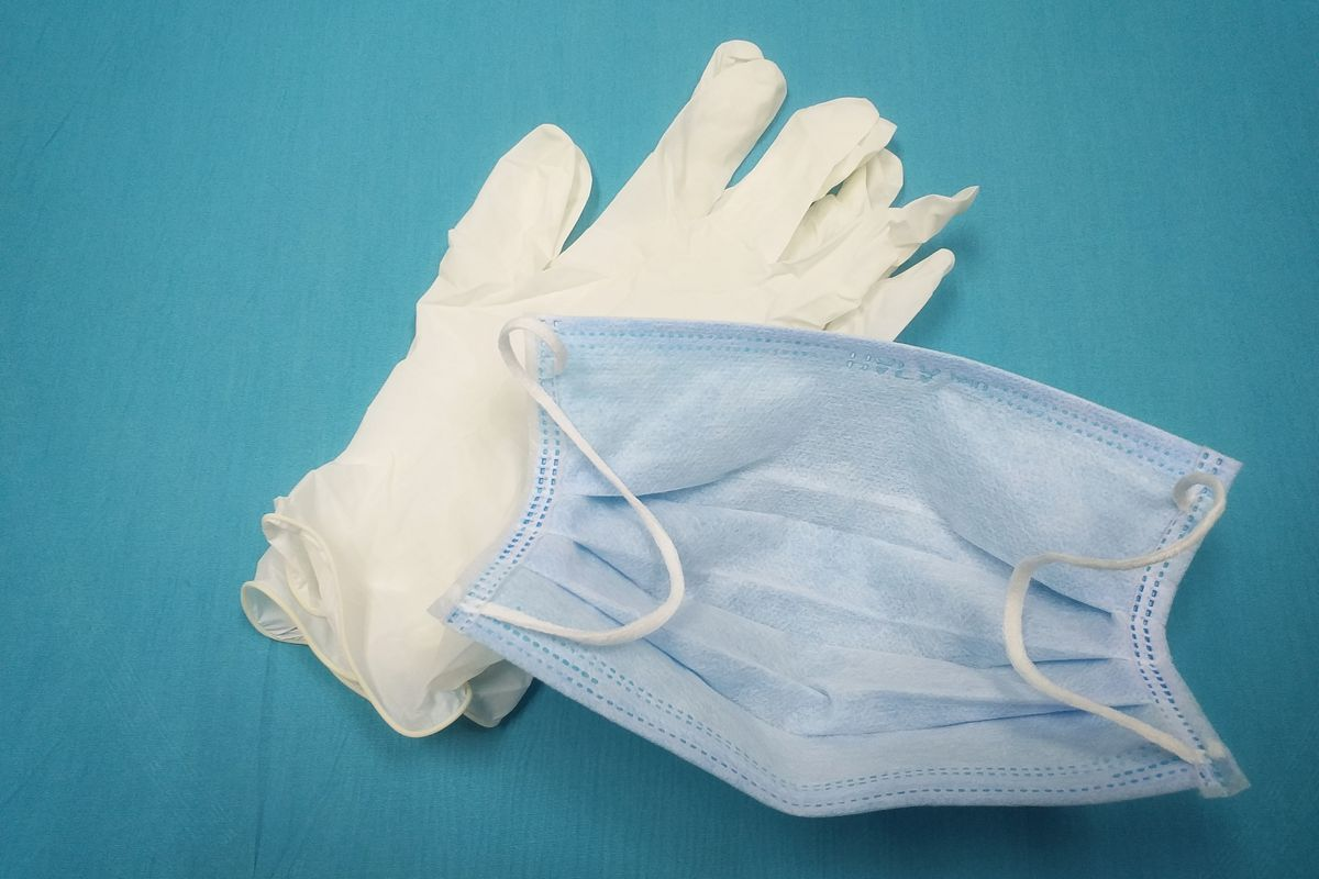Selective focus and blurry top views surgical mask and white medical gloves.