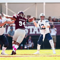 BYU quarterback Tanner Mangum, right, looks to pass as Mississippi State defensive lineman Jeffery Simmons closes in during the first half at Davis Wade Stadium in Starkville, Miss., on Saturday, Oct. 14, 2017.