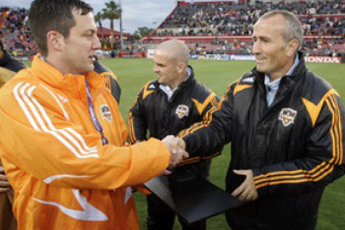 Chris Canetti presents a 2007 MLS Cup medal to Dynamo head coach Dominic Kinnear. The relationship between these two will be vital over the next few seasons as the Dynamo try to regain the form of their MLS Cup-winning seasons.