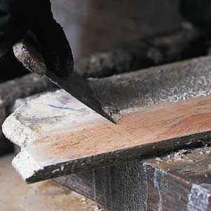 <p>USE A PUTTY KNIFE to scoop off the finish. Coarse steel wool or an abrasive pad are also good for scrubbing off stubborn paint.</p>