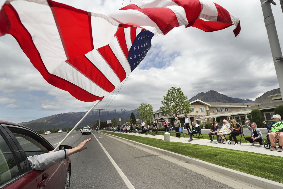 City officials, police officers and firefighters participate in a drive-by parade for the residents of Highland Glen Assisted Living in Highland on Wednesday, May 13, 2020 to show love and support for them.