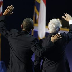 President Barack Obama, left, and former President Bill Clinton wave to delegates after Clinton's speech to the Democratic National Convention in Charlotte, N.C., on Wednesday, Sept. 5, 2012. (AP Photo/Lynne Sladky)