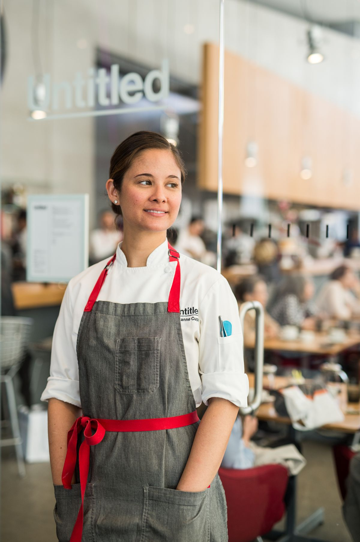 Suzanne Cupps wearing a grey chef apron at Untitled