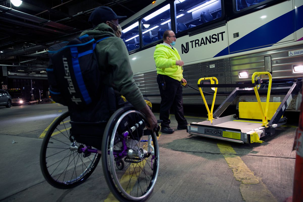 Port Authority workers assist Saheed Adebayo Aare during his three-hour commute.