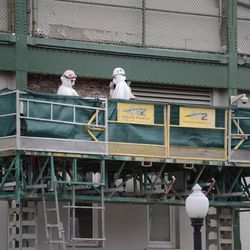 11:21 a.m. Bricks starting to become exposed. This is on the Addison Street side of the marquee -