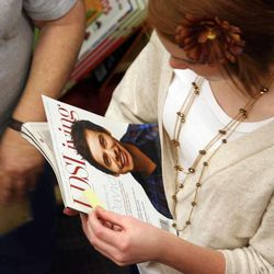 Nicole Smith waits with her magazine in the line to see David Archuleta, and have him sign it, during a book signing event at the Deseret Book at Ft. Union in Midvale on Nov. 22.