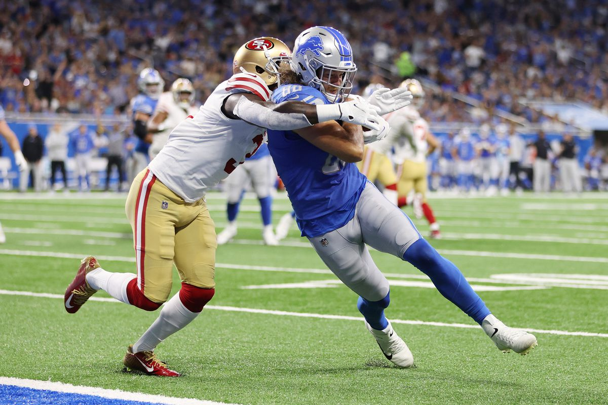T.J. Hockenson #88 of the Detroit Lions scores a touchdown past Jaquiski Tartt #3 if the San Francisco 49ers during the second quarter at Ford Field on September 12, 2021 in Detroit, Michigan.