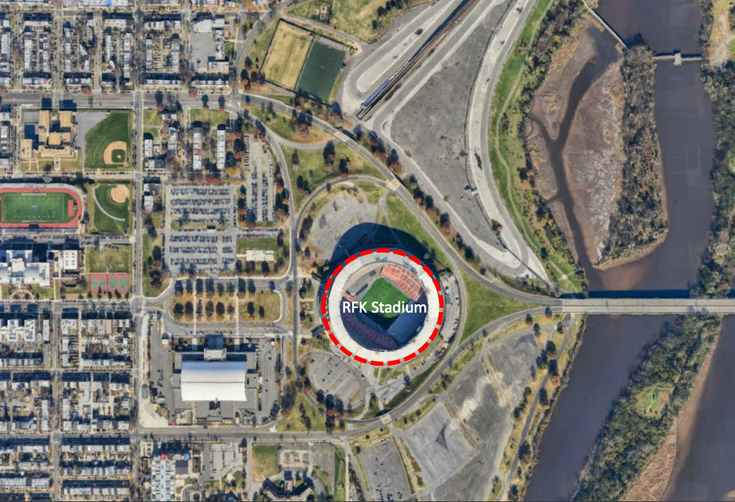A street grid showing a former football stadium along a river and near homes.