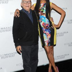 Designer Max Azria poses with model Selita Ebanks before the BCBG MAX AZRIA Spring 2013 collection is shown at Fashion Week in New York, Thursday, Sept. 6, 2012.