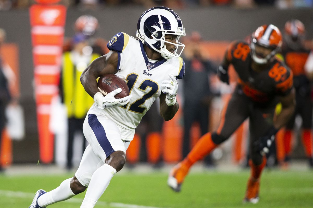 Los Angeles Rams wide receiver Brandin Cooks runs the ball for a first down against the Cleveland Browns during the fourth quarter at FirstEnergy Stadium.