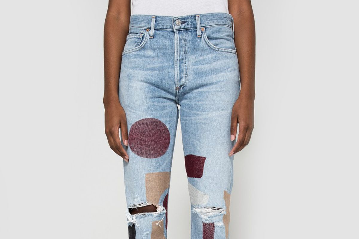 light wash jeans with painted shapes on them