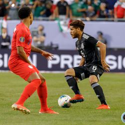 July 7, 2019 - Chicago, Illinois, United States - Mexico midfielder Jonathan dos Santos (6) cuts away from USA midfielder Weston McKennie (8) during the Gold Cup Final at Soldier Field.