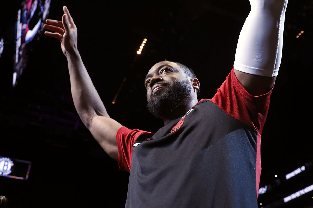 Miami Heat guard Dwyane Wade (3) acknowledges cheers from the crowd before the start of the final NBA basketball game of his career, against the Brooklyn Nets in New York. (AP Photo/Kathy Willens, File)