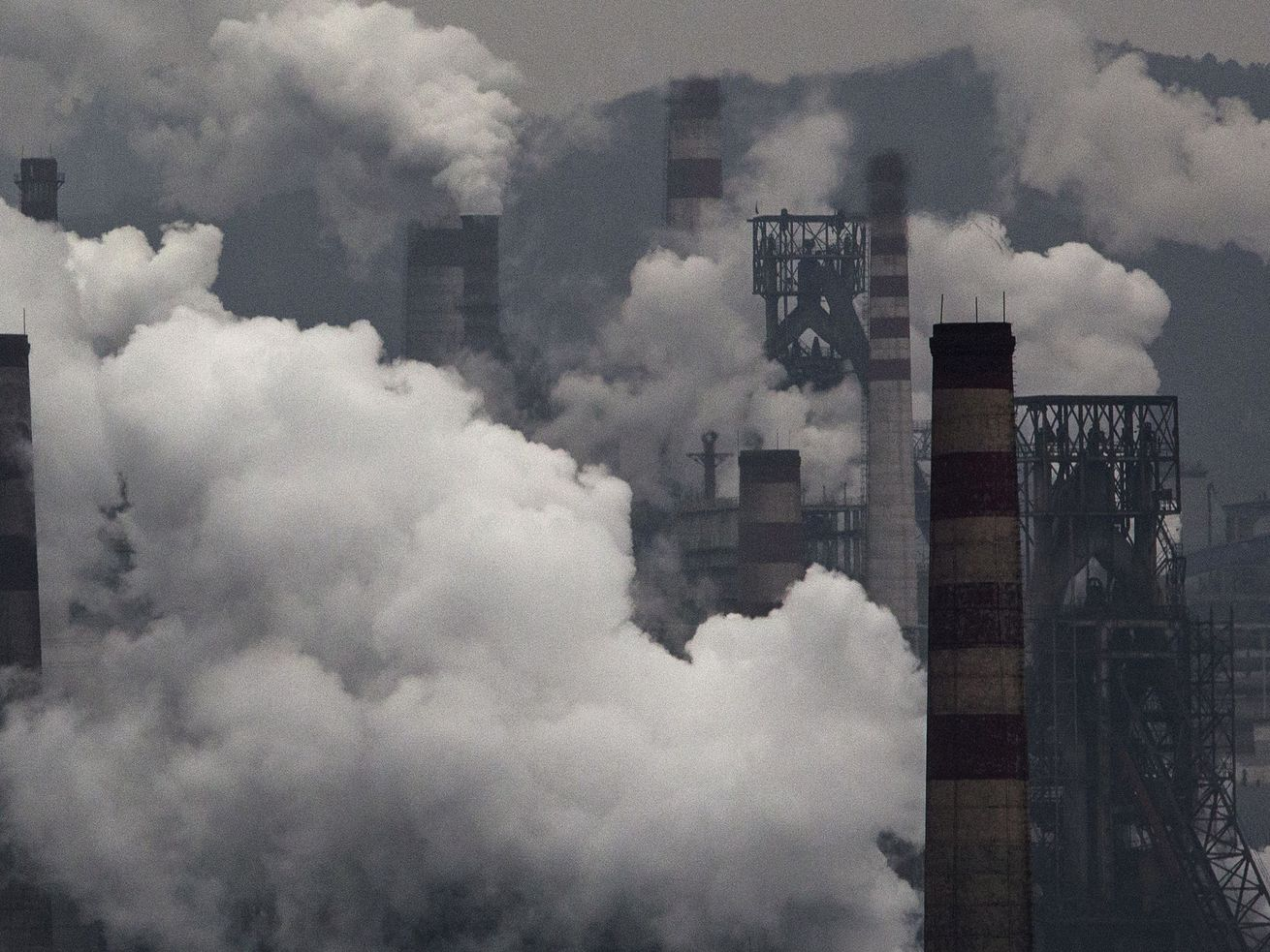 Smoke billows from smokestacks and a coal fired generator at a steel factory in Hebei, China. The IPCC will warn that the world isn't doing enough to clean up facilities like this one.