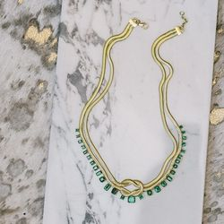 18 karat gold 'Revival Love Knot' necklace with emeralds, $56,700