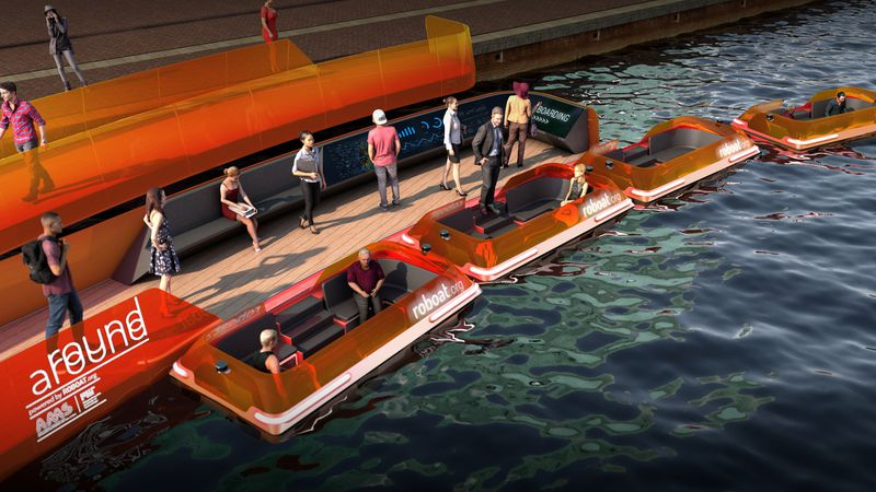 People stand on a dock in a rendering of the small orange electric boats.