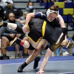 Ashley Wilcox of Copper Hills takes Jessica Nowers of Davis down as they wrestle in class 136 as girls compete for the 6A State Wrestling championship at West Lake High in Saratoga Springs on Monday, Feb. 15, 2021.