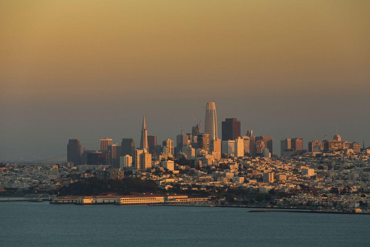 Sunlight reflecting on a hazy fog bank over San Francisco's skyline.