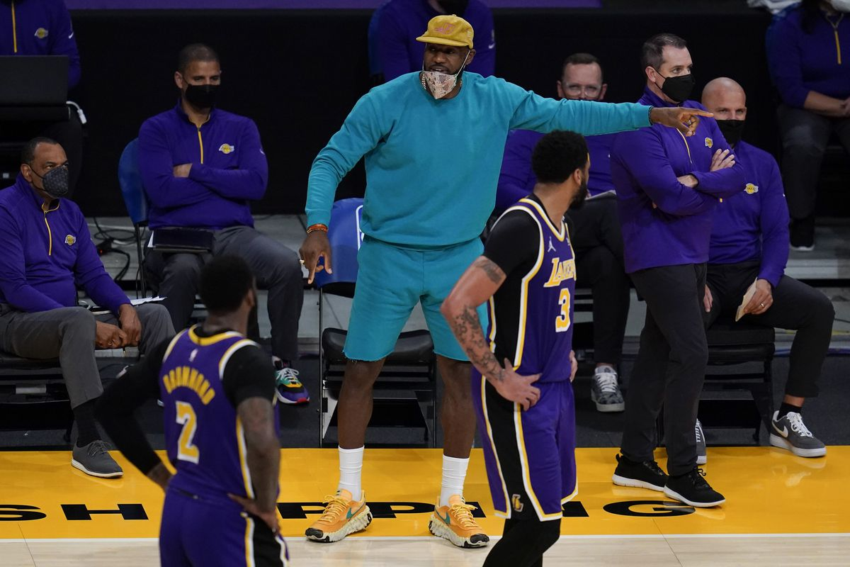 LA Lakers forward LeBron James coaches up teammates Andre Drummond (2) and Anthony Davis. The NBA playoff season is near.