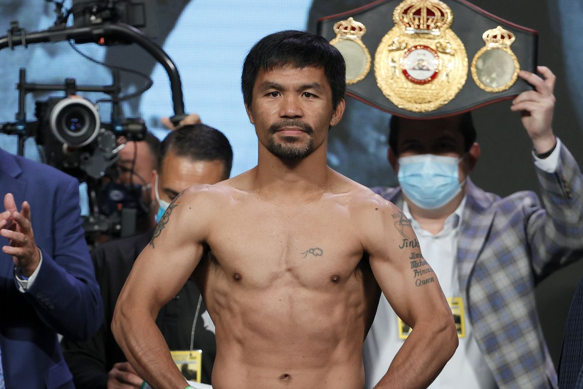 Manny Pacquiao poses on the scale during his official weigh-in at MGM Grand Garden Arena on August 20, 2021 in Las Vegas, Nevada.