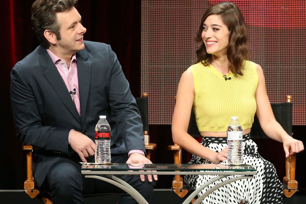 Actors Michael Sheen and Lizzy Caplan speak onstage during the Masters of Sex panel discussion at the Showtime portion of the 2015 Summer TCA Tour at The Beverly Hilton Hotel on August 11, 2015, in Beverly Hills, California.