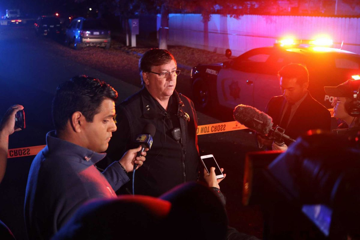 Fresno Police Lt. Bill Dooley speaks to reporters at the scene of a shooting at a backyard party Sunday, Nov. 17, 2019, in Fresno, California.