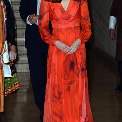 Kate wears a $1,050 dress by Beulah London, featuring the national flower of Bhutan, the poppy.