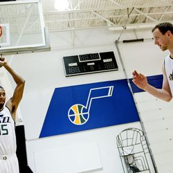 """Utah Jazz forward Joe Ingles talks about """"Toy Story"""" with forward Derrick Favors during Media Day at Zions Bank Basketball Center in Salt Lake City on Monday, Sept. 26, 2016."""