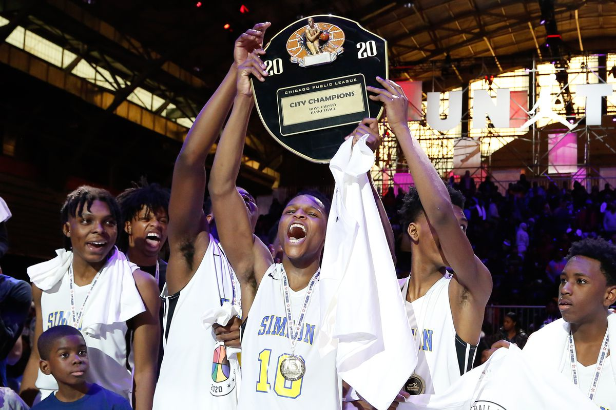 Simeon's Frederick Poole (10) holds up the City Championship Trophy with his teammates after winning the game against Morgan Park.