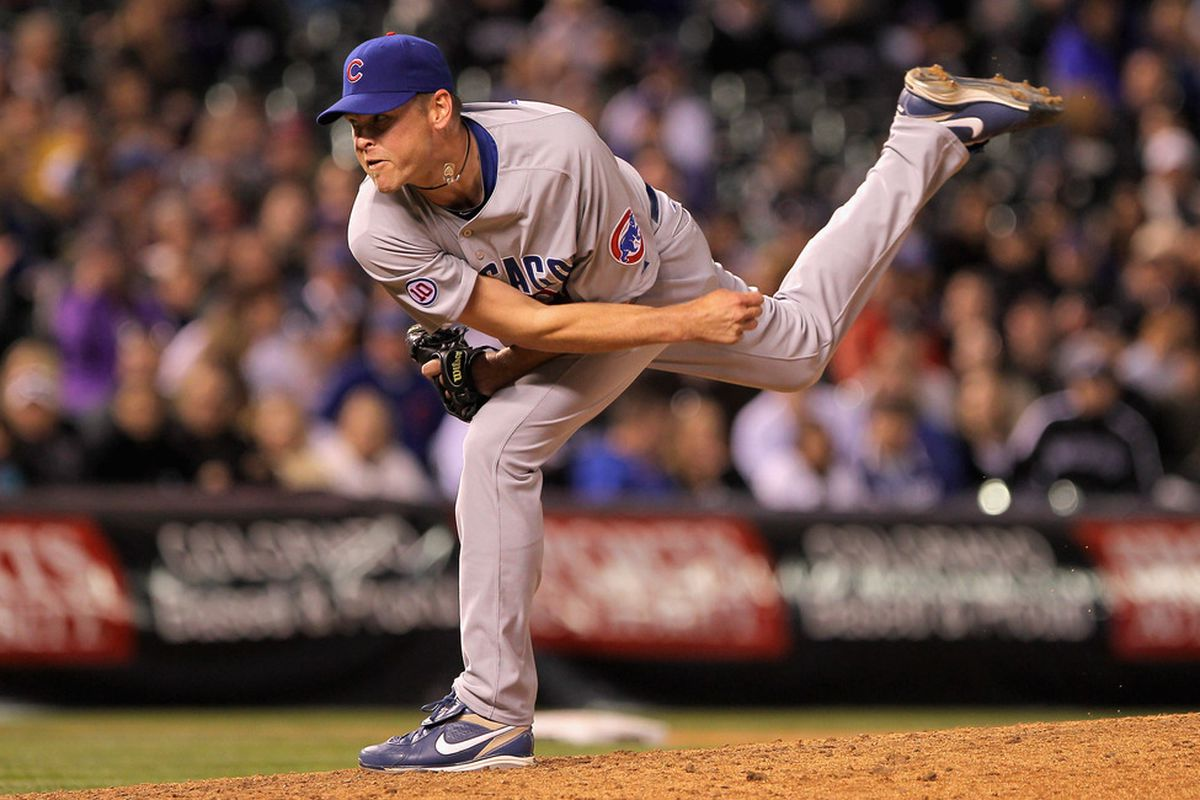 Relief pitcher Kerry Wood #34 of the Chicago Cubs works against Jason Giambi #23 of the Colorado Rockies in the eighth inning at Coors Field on April 16, 2011 in Denver, Colorado.  (Photo by Doug Pensinger/Getty Images)