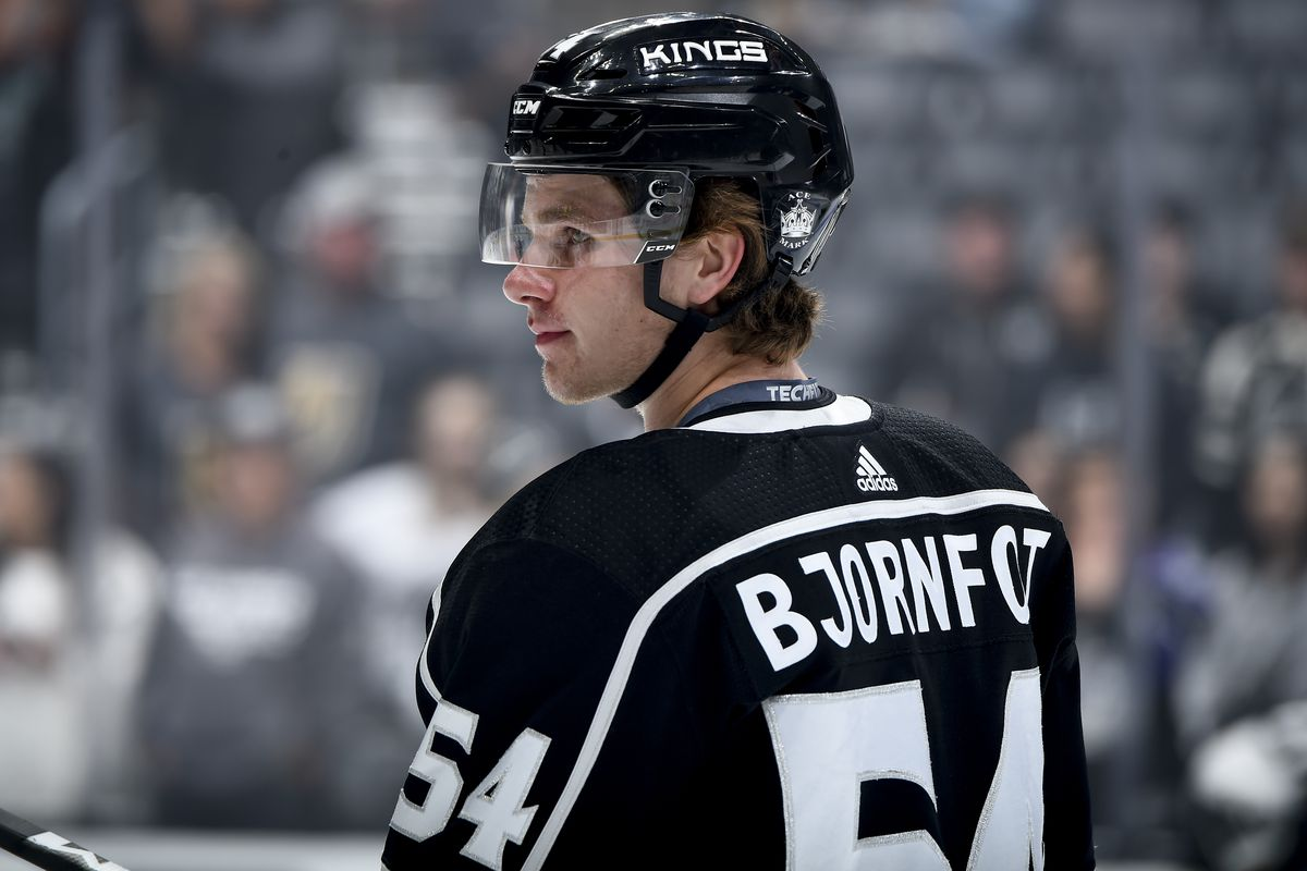 Tobias Bjornfot #54 of the Los Angeles Kings watches warm-up before the preseason game against the Vegas Golden Knights at STAPLES Center on September 19, 2019 in Los Angeles, California.