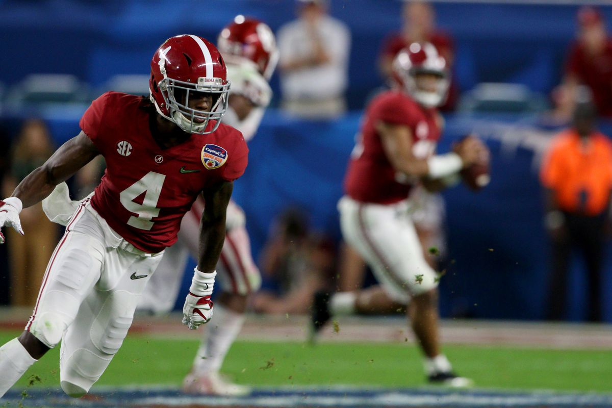 Alabama Crimson Tide wide receiver Jerry Jeudy runs a route as quarterback Tua Tagovailoa makes the throw against the Oklahoma Sooners during the third quarter of the CFP Semifinal at the Orange Bowl at Hard Rock Stadium in Miami Gardens, Florida.