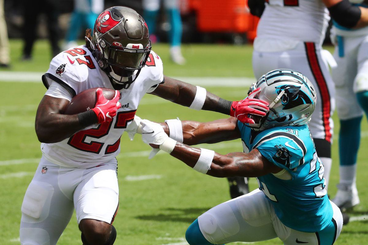 Tampa Bay Buccaneers running back Ronald Jones (27) stiff arms Carolina Panthers strong safety Juston Burris (31) to score a touchdown during the first quarter at Raymond James Stadium.