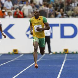 Jamaica's Usain Bolt, races clear of David Alerte of France, left, and Rondell Sorrillo of Trinidad and Tobago to win a Men's 200m semifinal during the World Athletics Championships in Berlin on Wednesday.