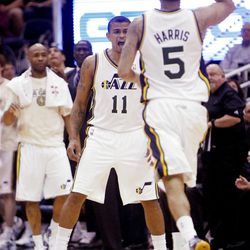 Utah Jazz guard Earl Watson (11) meets teammate Utah Jazz guard Devin Harris (5) out on the floor after a three point shot by Harris as the Utah Jazz and the Golden State Warriors play Friday, April 6, 2012 in Salt Lake City. Jazz won 104-98.