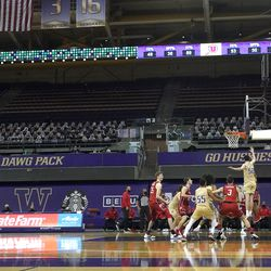 Washington plays Utah during the second half of an NCAA college basketball game, Sunday, Jan. 24, 2021, before empty seats in Hec Edmundson Pavilion in Seattle. Due to the COVID-19 pandemic, fans were not allowed to watch the game in person.
