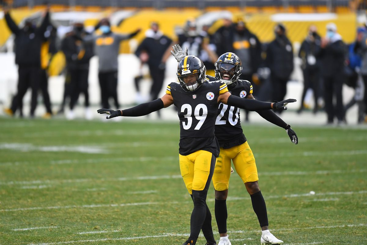 Safety Minkah Fitzpatrick #39 and cornerback Cameron Sutton #20 of the Pittsburgh Steelers react after an incomplete pass on fourth down and eight by the Indianapolis Colts to turn over the ball on downs in the fourth quarter of their game at Heinz Field on December 27, 2020 in Pittsburgh, Pennsylvania.