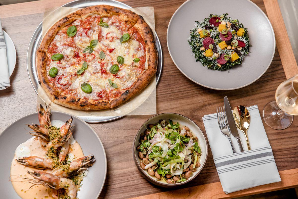 Sofia's margherita pizza, shrimp scampi, beet salad, and squid