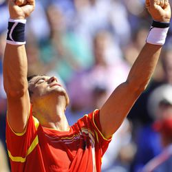 Spain's David Ferrer celebrates after winning against Sam Querrey of US, unseen, in the first single matchs at Davis Cup World Group Semi-final tennis match in Gijon, northern Spain, Friday, Sept.14 , 2012. Ferrer won the match 4-6, 6-2, 6-2, 6-4.