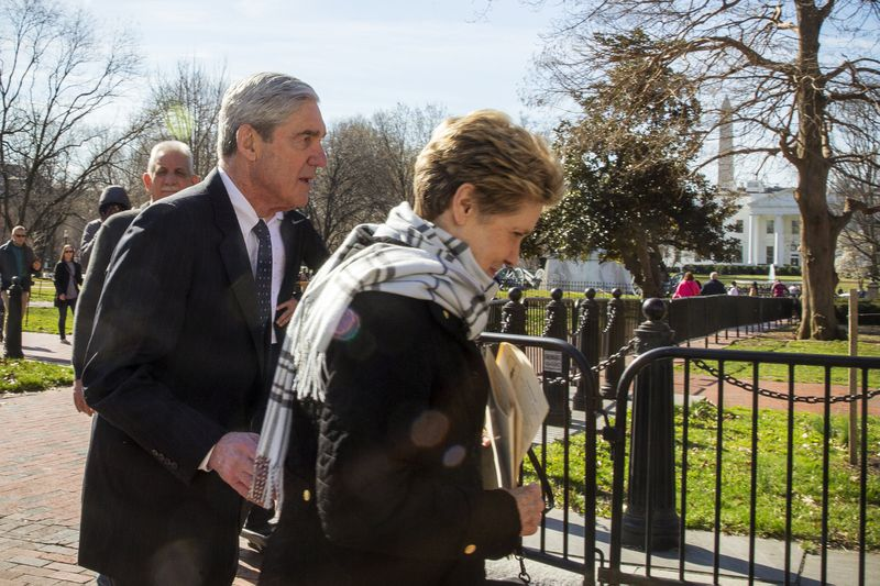 Special CounselRobert Mueller walks with his wife Ann Mueller in Washington, DC., on March 24, 2019.