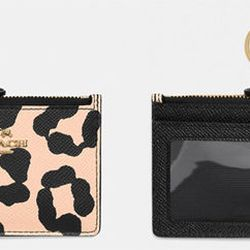 Go playful with your small leather goods! This ocelot print <b>Coach Mini Skinny</b> may be thin in size, but you'll still be able to organize all your money-related essentials. The zipper top compartment gives you space for your cash, change and features