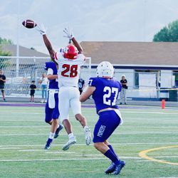 American Fork's Bodie Schoonover tips a pass as the Cavemen play at Lehi during the 2019 season. Schoonover had nine tackles and a sack in the game.