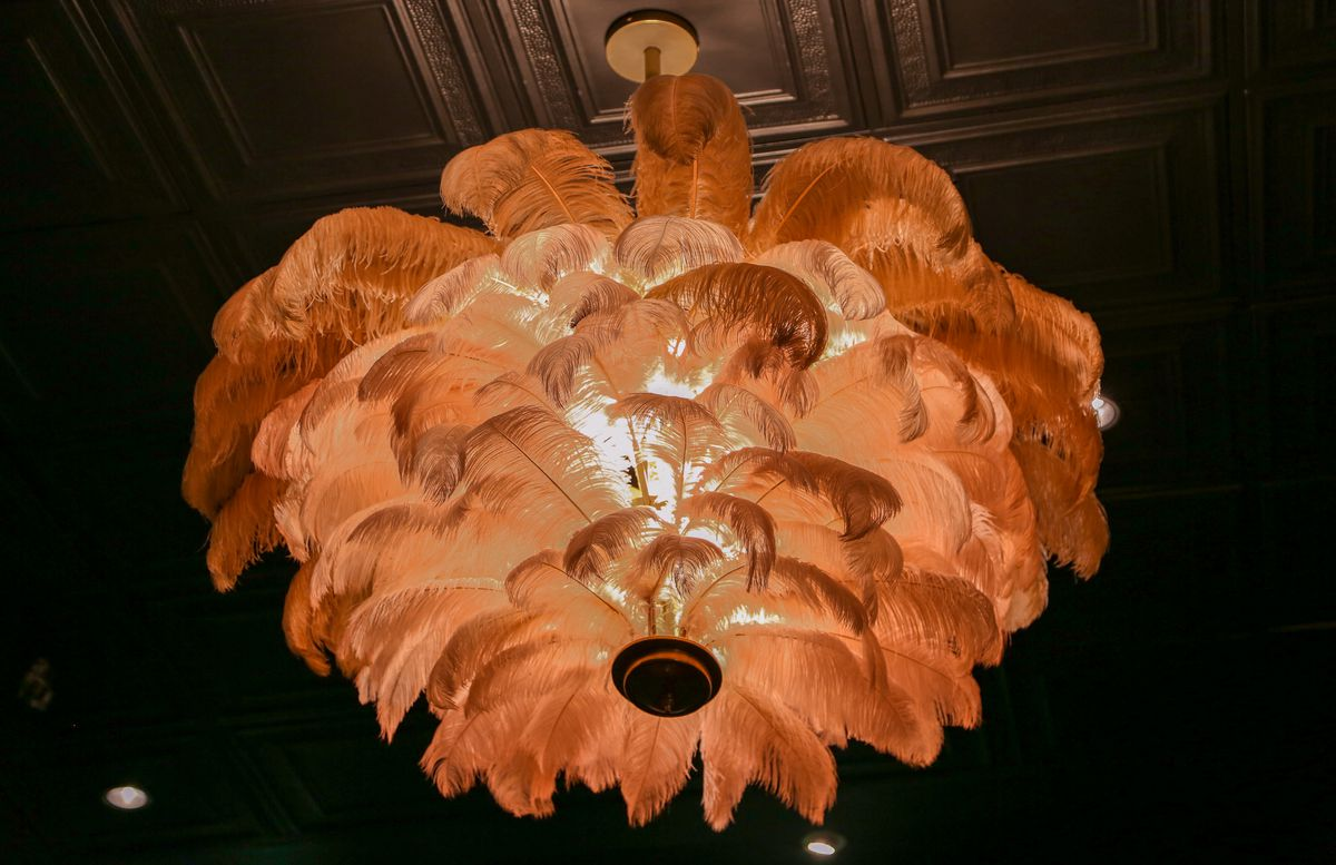 A hanging chandelier made with pink ostrich feathers