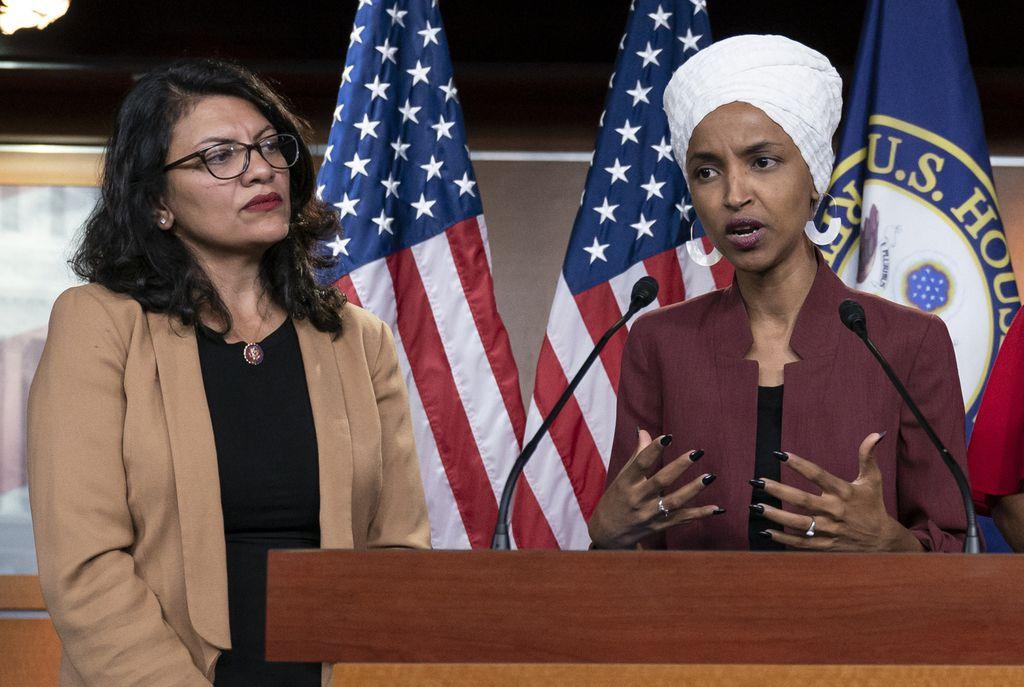 U.S. Rep. Ilhan Omar, D-Minn, right, speaks, as U.S. Rep. Rashida Tlaib, D-Mich. listens,