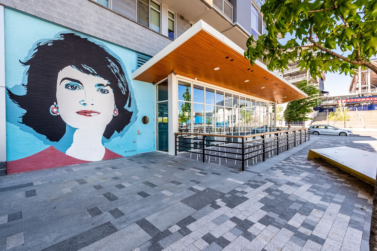 A mural of Jacqueline Kennedy Onassis greets guests outside Dacha Navy Yard.